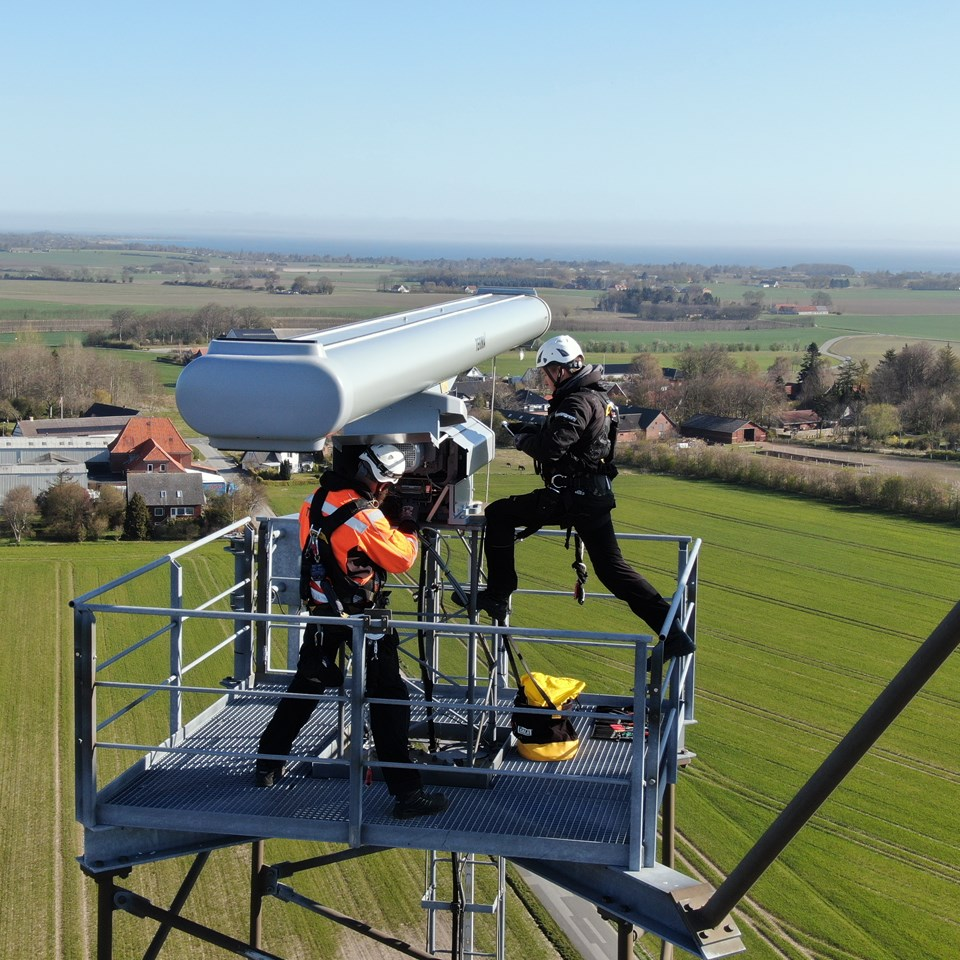 Two Terma Employees working at a radar tower